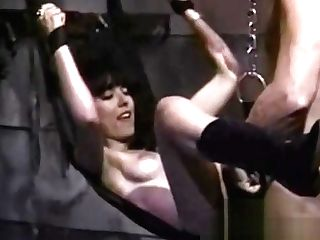 Stunning Raven-haired Slag Gets Plumbed While Being Suspended